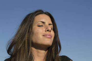 Satisfied woman in the evening sun - meditation