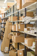 Shelves with parcels in the post office.