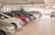 Many cars in parking lot or garage. - 64328300