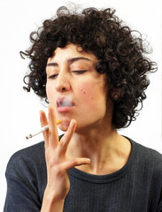 Young woman smokes