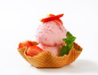Strawberry ice cream in waffle basket
