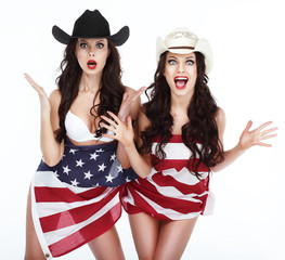 Two Funny Happy Women in Hats Wrapped in USA Flag