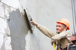 Plastering multi storey building wall of concrete blocks