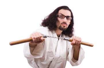Karate man with nunchucks isolated on white