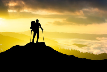 Silhouette of tourist on mountain peak