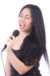 Young female singer with mic on white