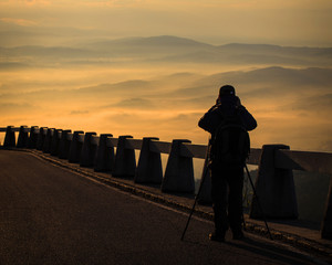 Photographer photographing landscapes morning