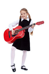 Little girl in black dress holding red guitar