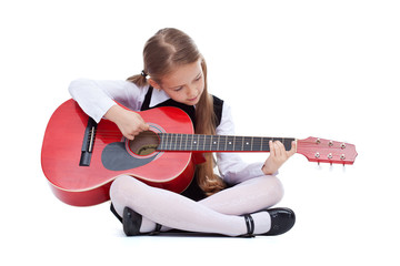 Little girl with red guitar, sitting