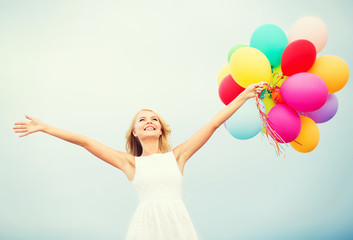 woman with colorful balloons outside