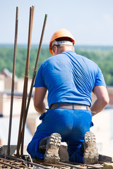 Builder worker mounting form work during concreting works