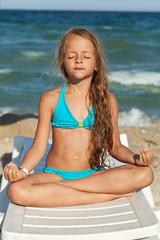 Little girl relaxing on the beach