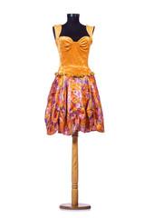 Orange dress on the dummy isolated on the white