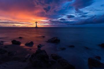 Sea sunset and christian cross