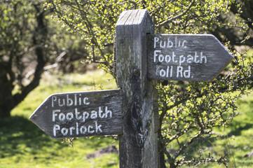 wooden public footpath sign on Porlock hill