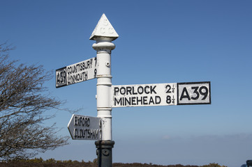 vintage metal road direction sign on top of Porlock Hill