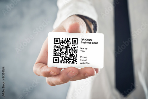 Businessman holding QR code business card