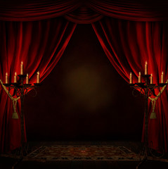 room with red curtains and candles