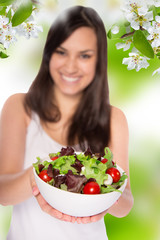 Attractive smiling woman eating salat