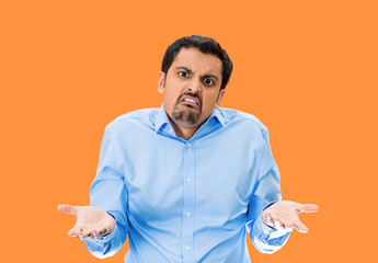 SO? Upset arrogant man asking who cares? orange background