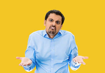 SO? Upset arrogant man asking who cares? yellow background