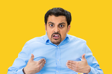 Angry man asking you mean ME? isolated on yellow  background