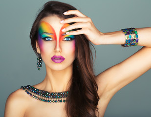Portrait of a beautiful girl with a fashion bright multicolored