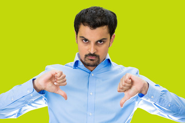 Angry Man giving Thumbs down, isolated green background