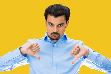Angry Man giving Thumbs down, isolated yellow background