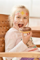 Little girl eating donut
