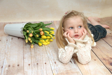 Girl with yellow tulips
