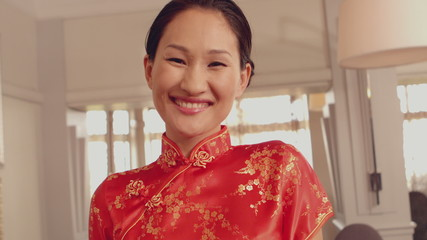 Asian waitress smiling at camera