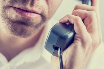 Man listening to a telephone conversation