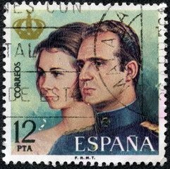 stamp printed in Spain shows King Juan Carlos and Queen Sophia