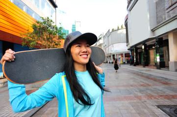 woman skateboarder on street