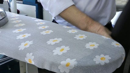 Ironing in Dry Cleaning Shop