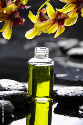 Poster Spa orchid with pebbles and massage oil on wet background