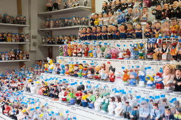 Modern caricature catalan caganers on  Christmas market