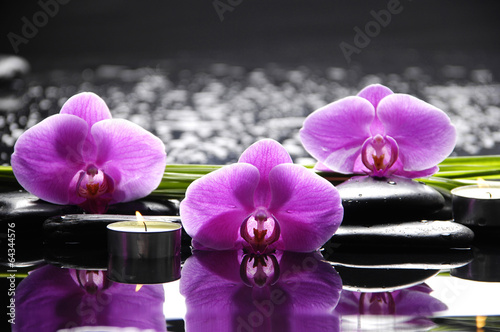 Spa still life with three orchid and stone with green leaf - 64344576