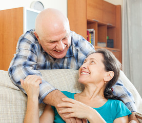 happy elderly man flirting with mature woman