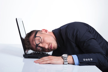 business man sleeps on laptop