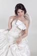 Portrait of beautiful bride sitting on luxury chair. Wedding dre