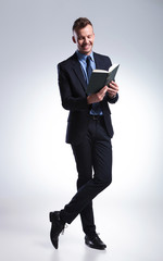 business man reads funny book