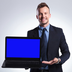 business man presents his laptop