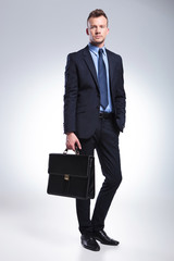young business man holds his suitcase