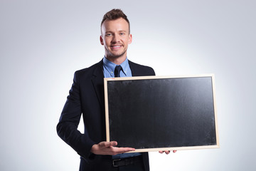 business man shows you a blackboard