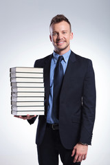 business man with a lot of books