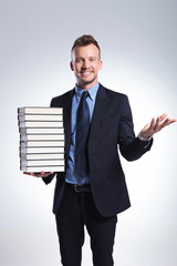business man welcomes you with books