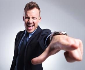 business man shouting at you