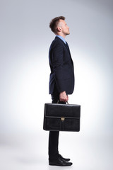 side of business man with briefcase